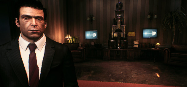 Bruce Wayne standing in an office.