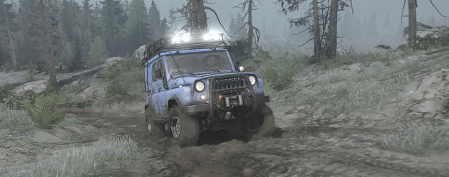 A jeep driving up a track, from the game