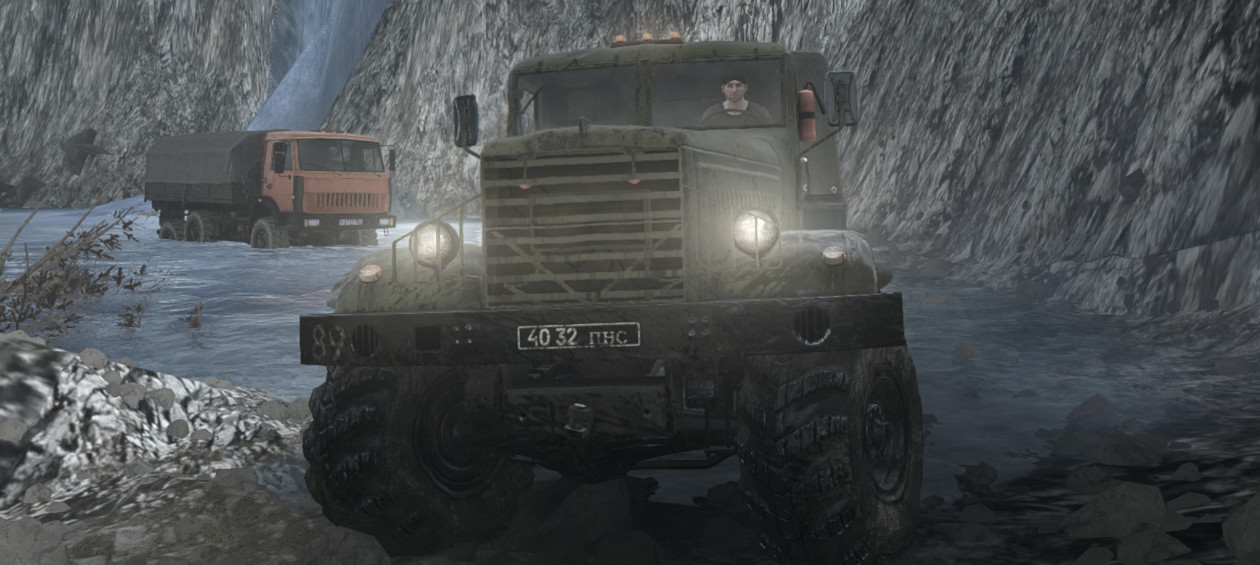 Two players driving trucks in MudRunner