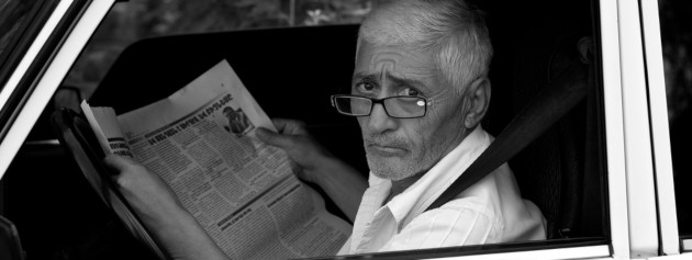 A man reading a newspaper, looking confused. Source: Thomas Leuthard, https://visualhunt.com/re/8fb5ee