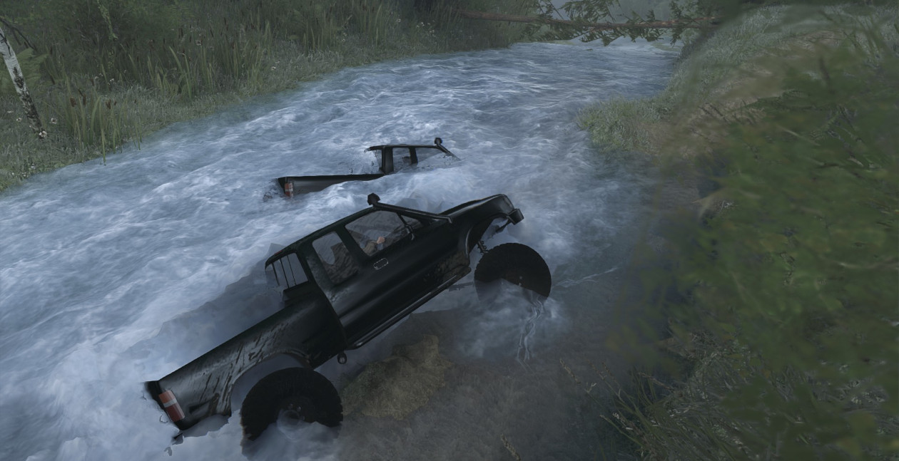 Both of us struggling to drive our trucks through a fast flowing river.