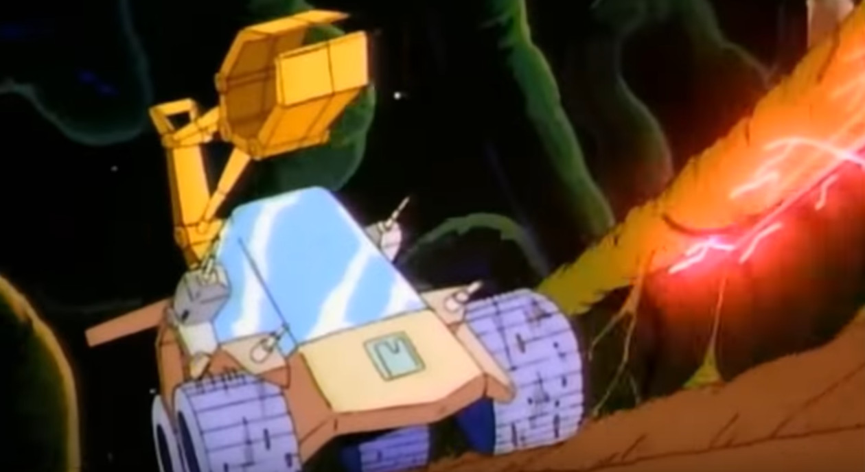 One of the vehicles from Jayce and the Wheeled Warriors, a yellow truck with a big arm on it.