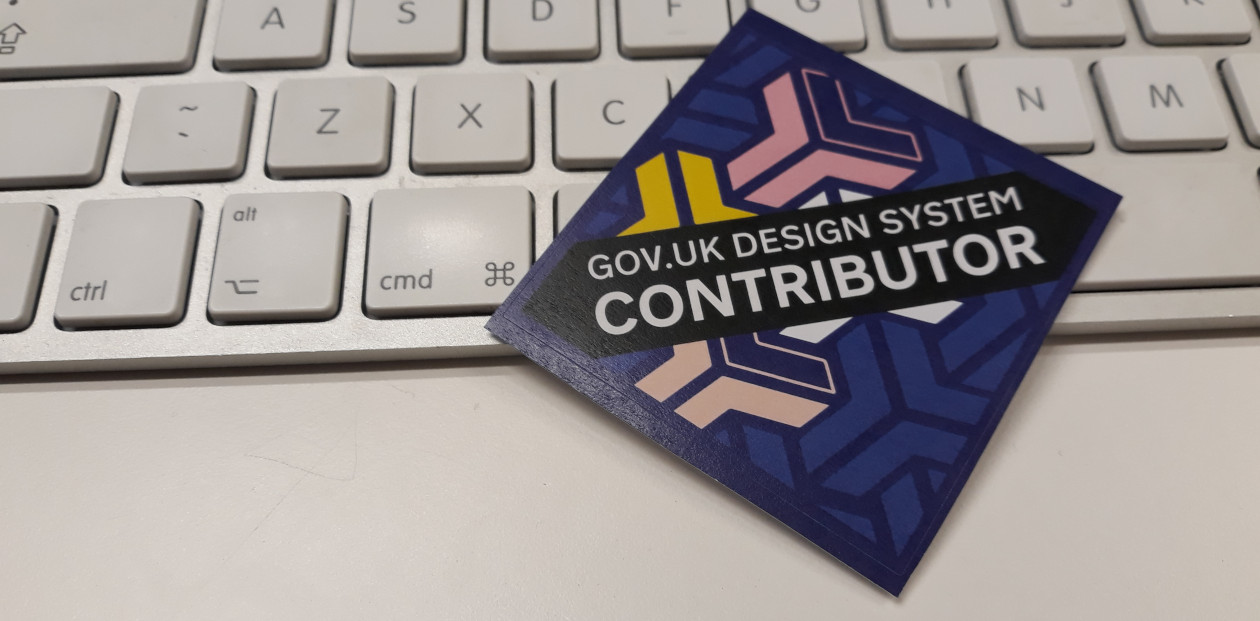 A sticker with 'GOV.UK Design System Contributor' written on it.